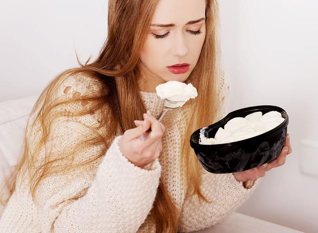 upset-woman-eating-ice-cream